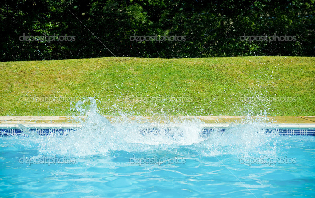 Large splash of water in a swimming pool — Stock Photo #6909553