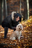 Girl and cocker spaniel — Stock Photo