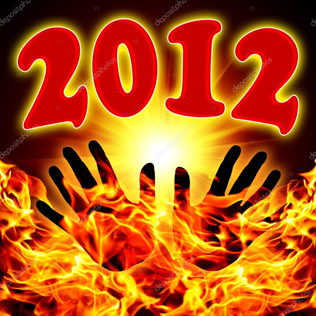 Birth of a new 2012 in sun beams with hands silhouettes  Stock Photo #7897465