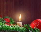 Christmas bauble twig and candle — Stockfoto