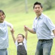 Joyful Asian family in the park — Stock Photo
