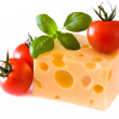 Yellow cheese with tomatoes — Stock Photo