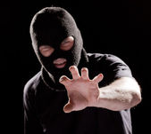 Burglar in mask — Stock Photo