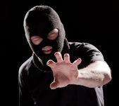 Burglar in mask — Stock Photo