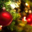 Christmas Ornament with Lighted Tree in Background, Copy Space — Stock Photo #7021774