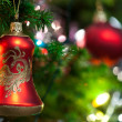 Christmas Ornament with Lighted Tree in Background, Copy Space — Stock Photo