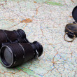 Old compass and binoculars on map — Stock Photo