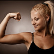 Woman flexing her biceps — Stock Photo