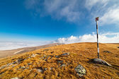 Pole marking route in mountains — Stock Photo