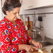 Senior woman in the kitchen — Stock Photo