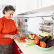 Senior woman in the kitchen — Stock Photo #7237706