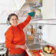 Senior woman in the kitchen — Stock Photo #7237707