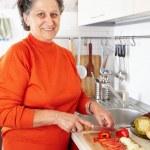 Senior woman in the kitchen — Stock Photo #7237708