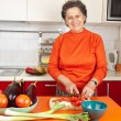 Senior woman in the kitchen — Stock Photo #7237711