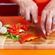 Senior woman's hands cutting vegetables — Stock Photo #7237718