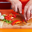 Stock Photo: Senior woman's hands cutting vegetables