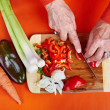 Senior woman&#039;s hands cutting vegetables - Stock Photo
