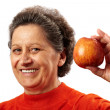 Senior woman with apple — Stock Photo #7237765