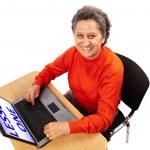 Senior lady at the computer — Stock Photo