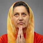 Old woman praying — Stock Photo #7237780
