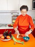 Senior woman in the kitchen — Stock Photo