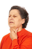 Old woman with laryngitis — Stock Photo
