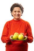 Senior woman with apples — Stock Photo