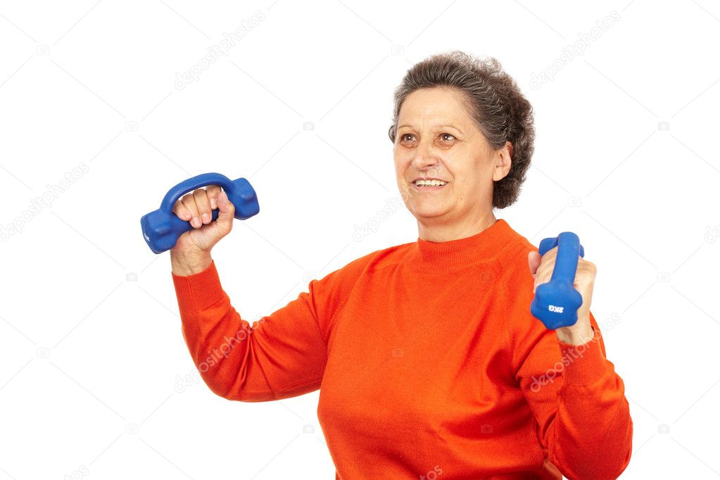 Active senior woman with dumbbells training, isolated on white  Stock Photo #7237723