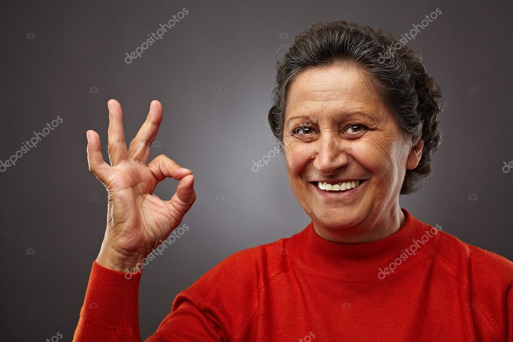 Portrait of a happy senior woman making ok sign — Stock Photo #7237788