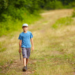 Stock Photo: Boy walking in forest