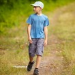 Boy walking in a forest - Lizenzfreies Foto