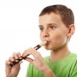 Boy playing the pipe — Stock Photo #7338481