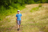 Boy walking in a forest — Stock Photo