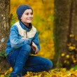 Boy in park with fallen leaves — Stock Photo #7418174