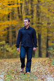 Man walking into the forest — Stock Photo