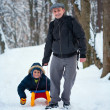 Father and son with a sledge — Stock Photo #7596043