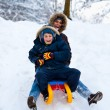 Stock Photo: Mother and son on a sledge