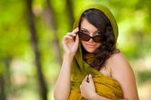 Beautiful woman with sunglasses outdoor — Stock Photo