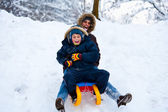 Mother and son on a sledge — Stock Photo