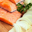 Red salmon fillets with condiments — Stock Photo