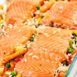 Salmon fillets with garnish — Stock Photo #7731113