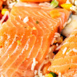 Salmon fillets with garnish — Stock Photo #7731119