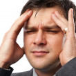 Young man with migraine - Stock Photo