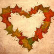 Royalty-Free Stock Photo: Autumn leaves vintage heart