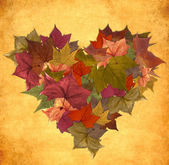 Vintage autumn leaves heart shape — Stock Photo