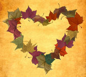 Vintage autumn leaves in empty heart shape — Stock Photo
