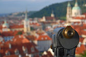 Old telescope and cityscape — Stock Photo