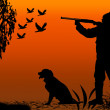 Hunter and canine silhouette — Stock Photo