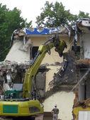 Demolition, construction. Crane dismantling building. — Stock Photo