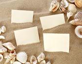 Card in beach sand — Stock Photo